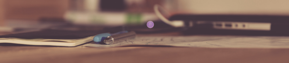Laptop en kladblok