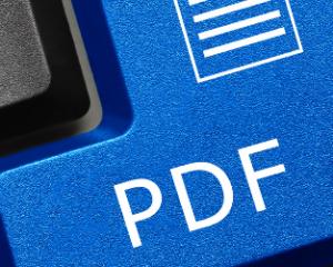 Een toetsenbord waarbij de entertoets is vervangen door een blauwe PDF knop